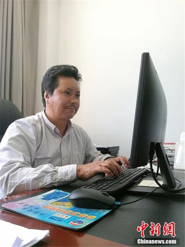 """边巴次仁:数字化工作让珍贵藏文古籍""""活起来""""1.jpg"""